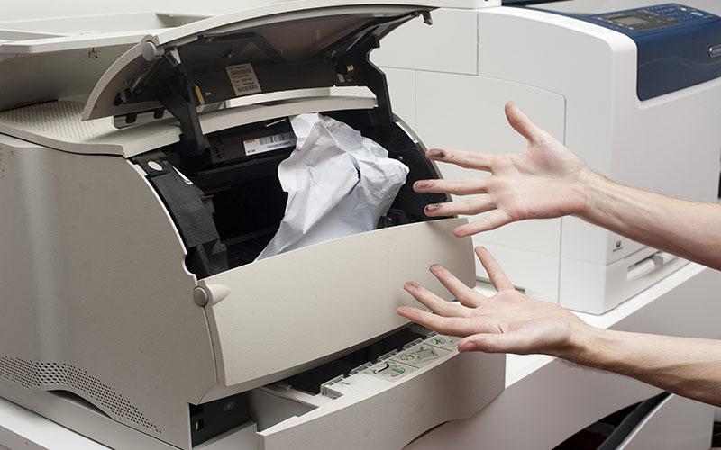 Nguyên nhân máy photocopy bị kẹt giấy